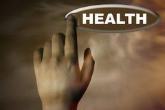 Mano y botón con la palabra de la salud Foto de archivo