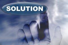 Mano y botón con la palabra de la solución Imágenes de archivo libres de regalías