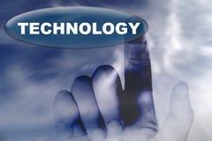 Mano y botón con la palabra de la tecnología Foto de archivo libre de regalías