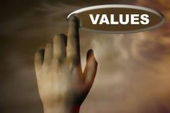 Mano y botón con la palabra de VALORES Imagen de archivo