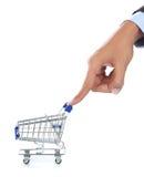 Mano y carro de compras Imágenes de archivo libres de regalías