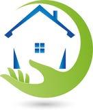 Mano y casa, propiedades inmobiliarias y logotipo de las casas