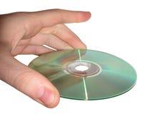 Mano y CD Fotografía de archivo libre de regalías