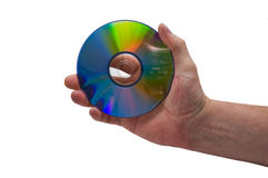 Mano y CD/DVD Fotografía de archivo