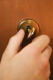 Mano y clave Foto de archivo libre de regalías