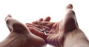 Mano y cruz Foto de archivo