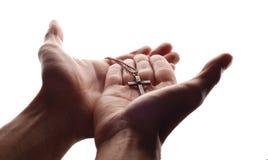 Mano y cruz foto de archivo libre de regalías