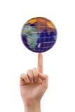 Mano y globo de giro imágenes de archivo libres de regalías