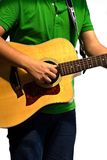 Mano y guitarra Imagen de archivo