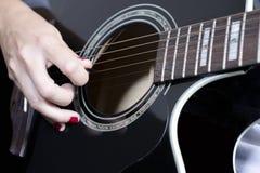 Mano y guitarra Imágenes de archivo libres de regalías