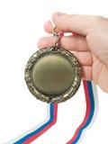 Mano y medal1 Imagen de archivo libre de regalías
