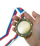 Mano y medalla imagenes de archivo