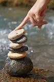 Mano y piedras Foto de archivo libre de regalías