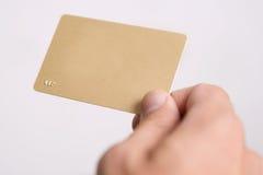 Mano y tarjeta vacía del vip Fotografía de archivo