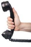 Mano y teléfono aislados contra el fondo blanco Imágenes de archivo libres de regalías