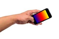 Mano y teléfono móvil Imagenes de archivo