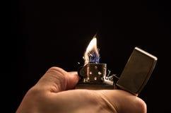 Mano y un encendedor Imágenes de archivo libres de regalías