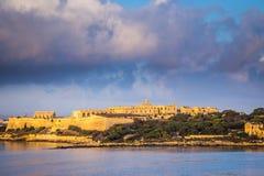 Manoel Island e forte Manoel no nascer do sol com nuvens bonitas Imagem de Stock