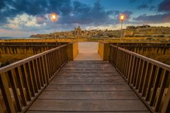 Manoel Island, Malta - Entrance of the beautiful Fort Manoel with St.Paul`s Cathedral. And Valletta at background at dusk stock photo