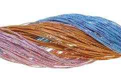 Manojo de cables en colores pastel Foto de archivo libre de regalías
