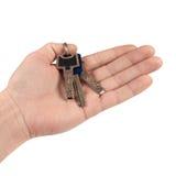 Manojo de claves en la mano. Imagenes de archivo