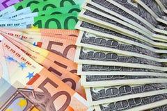 Manojo de dólares y de euro Imagen de archivo