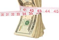 Manojo de efectivo que consigue exprimido Fotografía de archivo libre de regalías