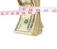 Manojo de efectivo que consigue exprimido Foto de archivo libre de regalías