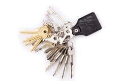Manojo de llaves y de llavero de cuero Imagenes de archivo