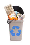 Manojo de materia vieja en una papelera de reciclaje Fotos de archivo libres de regalías