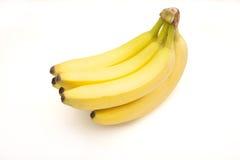 Manojo de plátanos aislados en blanco Fotos de archivo libres de regalías