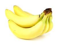 Manojo de plátanos aislados en el fondo blanco Foto de archivo