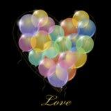 Manojo grande de globos del partido. Forma del corazón. Foto de archivo