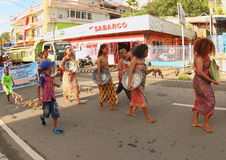 Manokwari Cultural and Art Festival 2017. Papuan women from Doreri in traditional costume walking on a parade. The plates they are holding are old plates Royalty Free Stock Photos