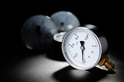 Manometer. On the black grained surface Royalty Free Stock Photography