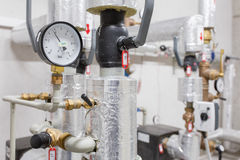 Manometer and heating pipelines Stock Photos