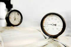 Manometer and heating pipelines Royalty Free Stock Photos