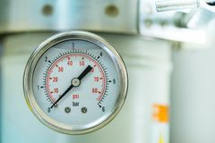 Manometer turbo pressure meter gauge in pipes oil plant Royalty Free Stock Images