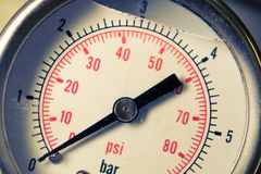 Manometer turbo pressure meter gauge in pipes oil plant Royalty Free Stock Image