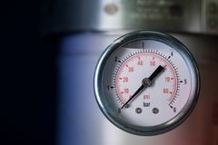 Manometer turbo pressure meter gauge in pipes oil plant Royalty Free Stock Photos