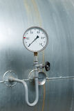 Manometer on the water tank. Royalty Free Stock Photo