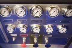 Manometers in liquid for measuring pressure in hydraulic system Stock Images