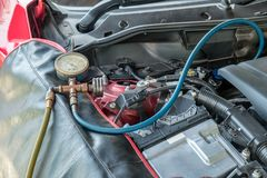 Manometers recharge refrigerant fill coolant to system engine ca. Manometers recharge refrigerant filling coolant to system engine car stock photo