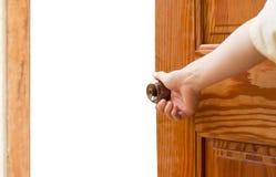 Manopola della porta aperta della mano delle donne o aprire la porta immagini stock