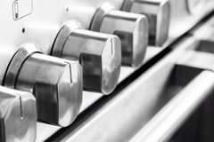Manopole del fornello dell'acciaio inossidabile fotografia stock