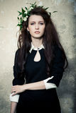 At a manor. Beautiful young lady in black dress at old manor Royalty Free Stock Images