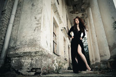 At a manor. Beautiful young lady in black dress at old manor Royalty Free Stock Photography
