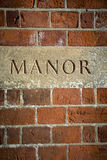 Manor carved sign at English grand residence Royalty Free Stock Photo