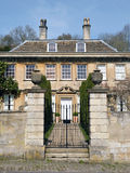Manor House. With View of Entrance, Gates and Garden Path Stock Image