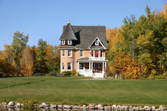 Manor House 2. A large stylish home in a fall setting Stock Image